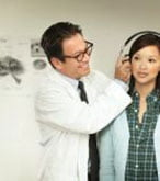 hearing test audiologist with female patient