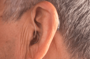 Elderly wearing hearing aid