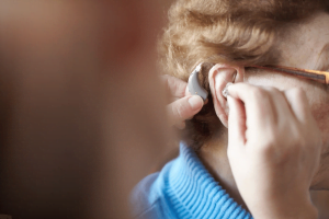 removing wet hearing aid