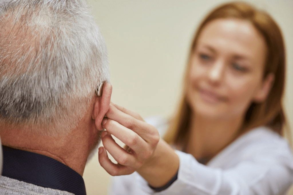 help a man wearing hearing aid