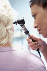 nurse examine a patient ear