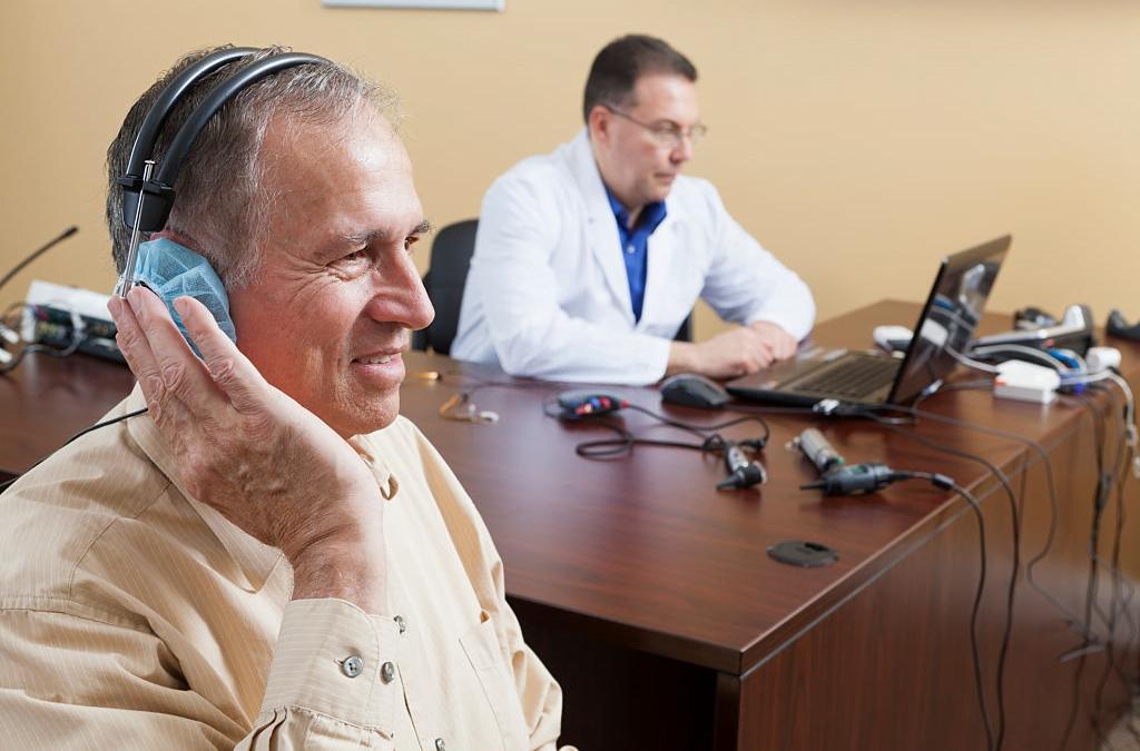 old man having hearing test