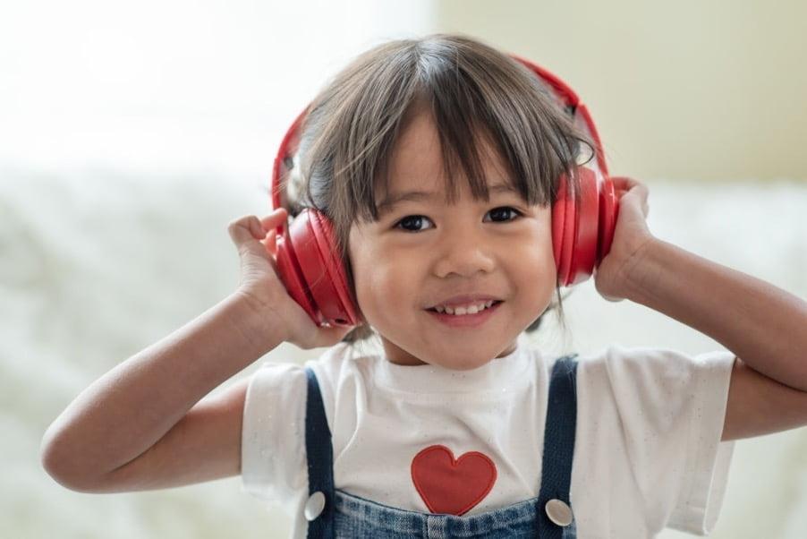 a kid wearing headphone