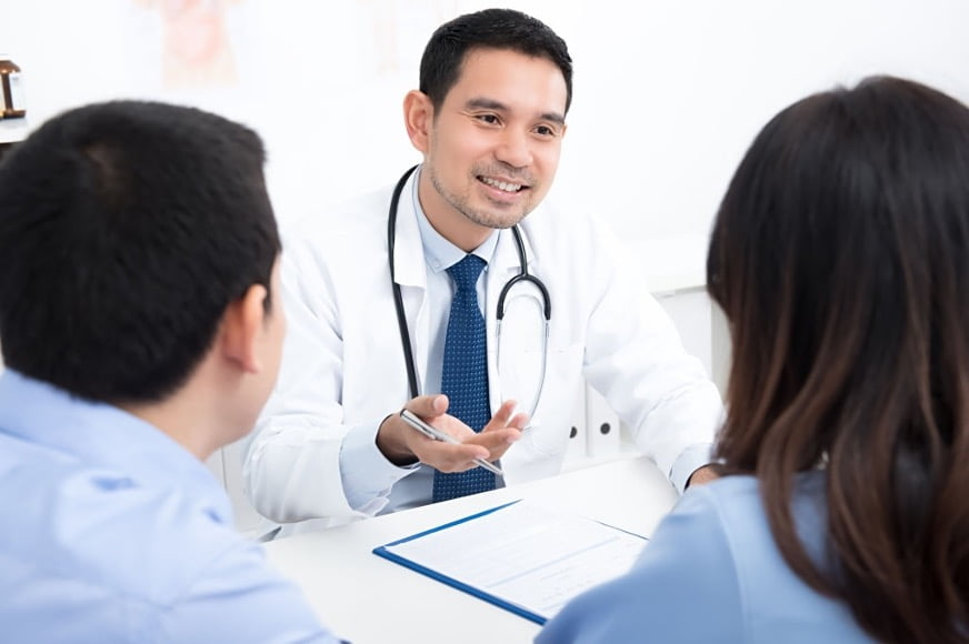 a male doctor giving consultation in a room
