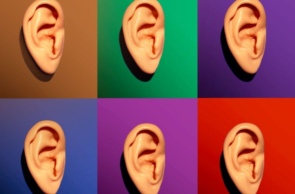 Set of 6 caucasian human ear models on 6 different colour backgrounds
