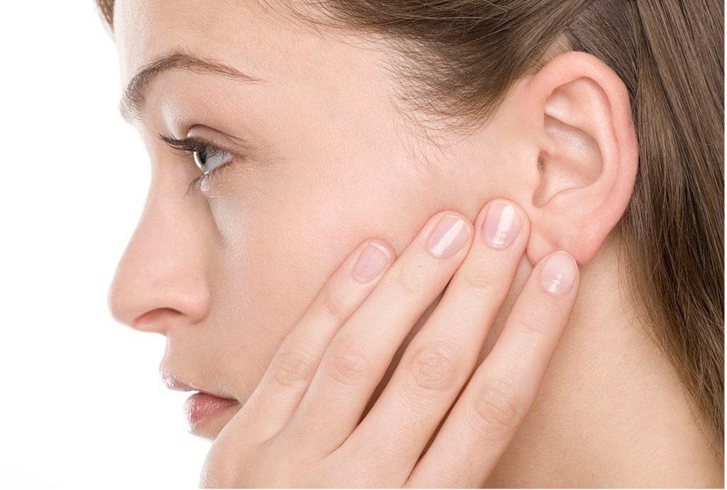 touching ear pain